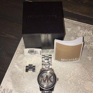 Michael Kors Jewelry - Women's Michael Kor's silver and diamond watch